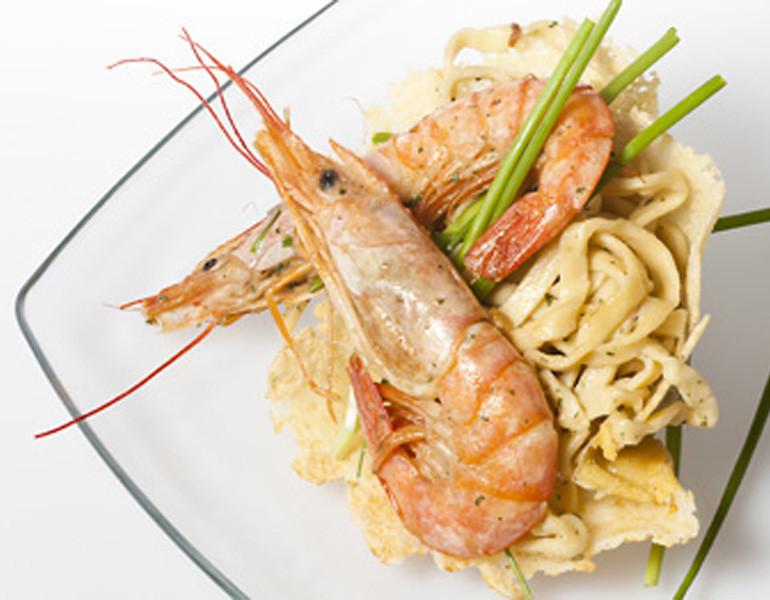 Basket of grain pasta and prawns